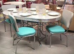 1950's Chrome and Formica Dinette Set.  It included one 12 inch leaf. This looks similar enough to the one we had growing up.