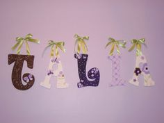 How to Hang Wooden Letters/Art on the wall--straight, staggered, with ribbon, on a curtain rod, etc.