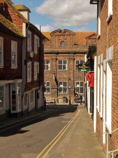 Looking down Lion Street onto the High Street and the old Grammar School in Rye, East Sussex, England.
