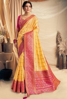 Yellow Color Checks Design Weaved Silk Georgette Saree Product Details : Fabric of this designer saree is weaved silk georgette. Saree color is yellow. Comes along with a pink color raw silk unstitched blouse. Saree has zari and cord embroidery, ban Georgette Sarees, Silk Sarees, Indian Sarees, Simple Lehenga, Checks Saree, Party Kleidung, Party Wear Lehenga, Yellow Blouse, Embroidered Clothes