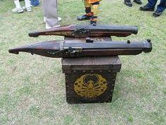 Two antique o-zutsu tanegashima (matchlock hand cannon).