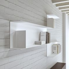 Fantastic white wall mounted shelving with a contemporary style.