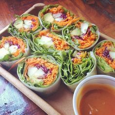 Veggie wraps + Peanut Sauce [spring roll wrappers, romain & spinach lettuce, red cabbage, grated carrots, avacado, cucumber, cilantro, thai basil, bean sprouts, aka any veggies. + whole foods peanut sauce-- homemade? peanut butter, garlic, soy sauce, lime juice, sriracha, coconut milk, cilantro]