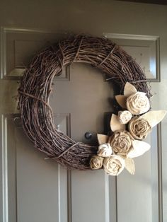 Grapevine Wreath with Burlap Flowers. $25.00, via Etsy made by Katelyn