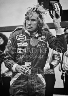 "British 1976 World Champion James Hunt, beer in hand, salutes the crowd after winning the 1977 United States Grand Prix at Watkins Glen. There might not be a better example of what has changed from the ""romantic"" era of the 70's to what we experience today.<br /> <br /> Talented McLaren driver James Hunt was one of the most complicated, charismatic and controversial individuals ever to compete in Formula One. He loved projecting his playboy image to the hilt and backed it up with outrageous…"