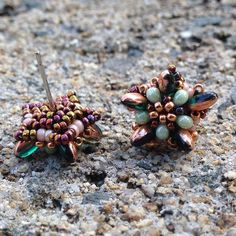 Beaded post earrings with rizo beads and peanut beads. Inspired by Bead Origami