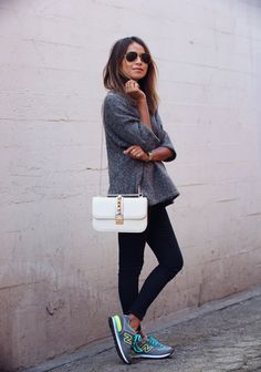 New Balance sneakers, black skinny jeans, grey loose sweater, Valentino bag