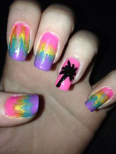 Neon rainbow with a palm tree accent