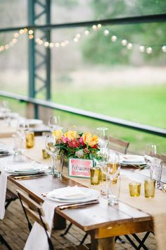 spring wedding table - photo by Sarah Goss Photography http://ruffledblog.com/colorful-modern-wedding-at-the-plant-at-kyle #weddingreception #weddingideas
