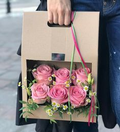 Make an paper flower and arrange it in a box like this for a present