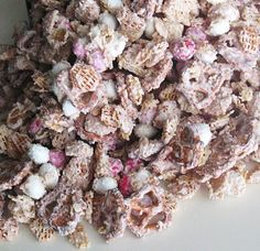 Valentine Trash  24 oz. vanilla flavored candy coating (almond bark)  6 cups Kellogg's Crispix cereal  3 cups round shaped pretzels  16 oz. M&M'S Peanut Chocolate Candies in Valentine Colors