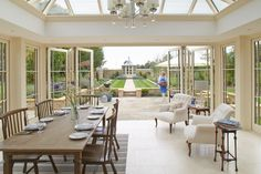 'Combine bi-fold doors and level flooring for the ultimate alfresco dining space' - thanks to for including this orangery image in their 'Patio Doors for Period Homes' feature, which is available now. Double Patio Doors, French Doors Patio, Sliding Patio Doors, Orangery Extension, Cotswold Villages, Period Living, Sliding Door Design, Timber Windows