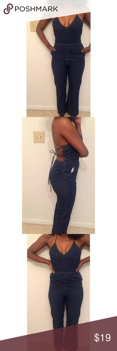 Denim Jean Jumpsuit Cute denim jumpsuit, worn once. Zips in the back. A little stretch. Lace up in the back. Not brand listed brand is Tobi Zara Pants Jumpsuits & Rompers