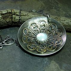 Dancing with the Moon - sterling silver and brass with mother-of-pearl  ...from LavenderCottage on Etsy