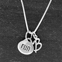 Create your own unique, personal running necklace with our Sterling Silver Oval Run and Sterling Silver Initial Necklace. Start with our simple but stunning oval run charm paired with a sterling silver initial charm.