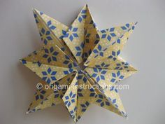 This is an elegant origami 8 pointed star that is perfect for the top of your origami christmas tree. Find out how to fold this beautiful origami star here. Diy Origami, Origami Paper Art, Origami Stella, Origami Christmas Star, Christmas Paper, Xmas, Origami 8 Pointed Star, Origami Stars, Crafts To Make