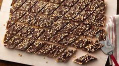 Chocolate, caramel and sea salt come together on a sugar cookie crust to create a decadent toffee bar experience. This one is a keeper!