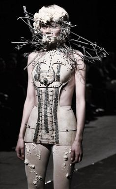 ... il est mon destin . Katarzyna Konieczka, sometimes known as Kasia Konieczka, makes costumes with a dark-conceptual bent. Strapped into body-cages, torturously wrapped in wire, her daemonic costumes give off impressions of space-age sci-fi medical fetish suits, and labyrinthine strapped asylum couture.