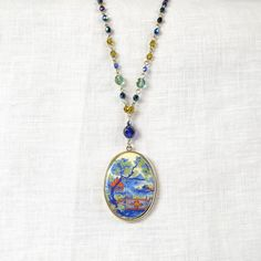 Bold Style: Graceful Asian Cameo Necklace with glistening cut glass beads **Altiplano