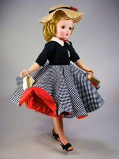 #2027 of 1956 with rare red petticoat.