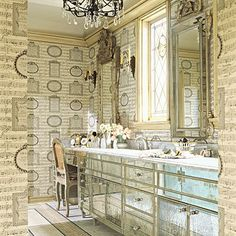 A tad busy...but the #mirrored #cabinets are cool