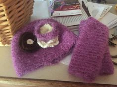 Crochet hat and leg warmers with changeable flowers