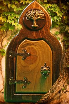 Tree of Life Fairy Door-I have an ivy covered stump in my backyard that this would look fit perfectly.