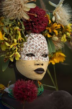 The Suri of southwestern Ethiopia are a relatively small and remote tribe that possess an extremely strong creative capacity to adorn their bodies with natural pigments and any item they can find from nature or otherwise. Cara Tribal, Tribal Face, We Are The World, People Of The World, Tribes Of The World, African Tribes, African Art, Ethiopian Tribes, Art Afro