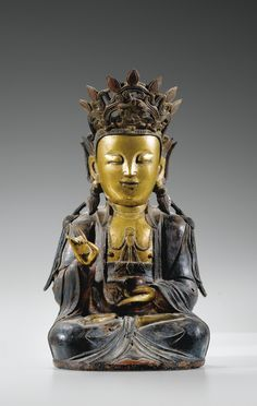 A PARCEL-GILT BRONZE FIGURE OF GUANYIN, MING DYNASTY, 17TH CENTURY