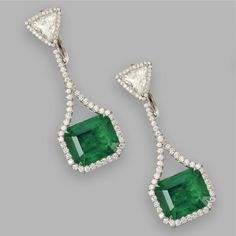 EMERALD AND DIAMOND PENDANT-EARRINGS Set with 2 emerald-cut emeralds weighing and carats, supported by 2 triangular-shaped diamonds weighing carats, all framed by small round diamonds, mounted in platinum. Emerald Earrings, Emerald Jewelry, Emerald Gemstone, Gemstone Earrings, Emerald Cut, Hanging Earrings, Pendant Earrings, Luxury Jewelry, Diamond Pendant