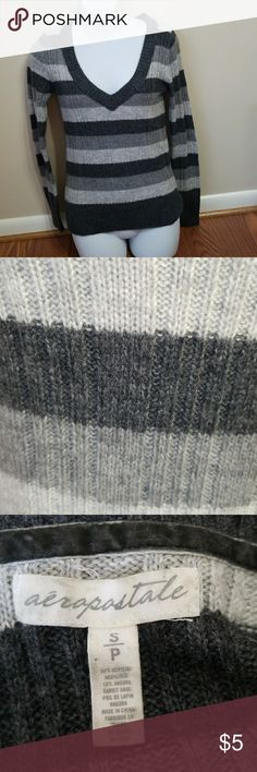 🌸 Aeropostale Grey Striped Sweater In good used condition. No stains or rips. Stripes are shades of grey. Light gray, dasrk grey and medium grey Aeropostale Sweaters V-Necks