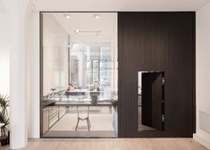 Uniform Wares London offices include a pivoting timber door