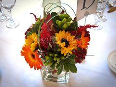 sunflowers, orange gerbera daisies, burgundy dahlia fall color centerpiece   designed by Perfect Princess Events