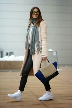 White high top sneakers in street style