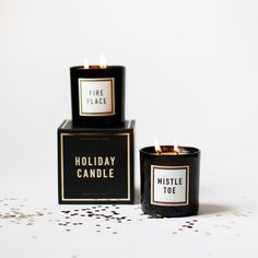 Mistletoe Double-Wick Holiday Soy Candle in Black Glass and Gold Foil Stamped Box.