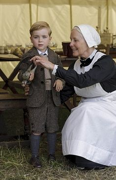 Young George (left) and is that a new nanny with him?...