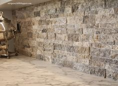 We finally finished the backsplash in the kitchen. I know I had talked about using this brick product: However the current sam...