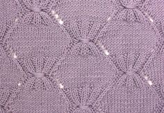 Pleated Diamonds is a large knitting stitch pattern, a multiple of 28 stitches,  that would be perfect for a baby blanket.  It is found in the Textured Stitches category.