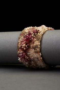 Rose Couture Cuff by Andrea Gutierrez. Bead embroidery on Thai silk with new & vintage seed beads, semiprecious stones, & hammered clasp