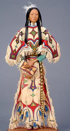 Lakota Beadwork Doll by Charlene Holy Bear: Quillwork, & parfleche designs, are handmade & inspired by Plains traditional dolls, which were flat & more utilitarian--they were used to teach girls about their roles in life. Holy Bear's dolls are 3-dimensional & honor the doll-making tradition with beauty & a contemporary style blended with art.
