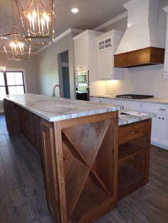 Check out this modern farmhouse kitchen. It has a Long Island with leather granite countertops, tons of storage, and a shiplap vent hood. Wood Kitchen Cabinets, Painting Kitchen Cabinets, Farmhouse Style Kitchen, Modern Farmhouse Kitchens, Leather Granite, Cottage Plan, Granite Countertops, Home Builders, Kitchen Design