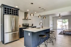 Navy blue shaker cabinets and mixed finishes pull together this Phoenix, AZ kitchen. This home is for sale in the Arcadia Lite neighborhood!