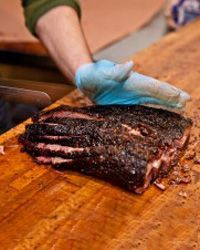 BBQ Brisket tips from Austin Texas' Aaron Franklin Barbque.  So good it has a cult following!  I have an inexpensive ($80) electric smoker from home depot and you can get wood chips at Walmart, kroger, etc..  I recommend hickory and apple wood and I prefer the larger chunks of wood to the chips.  Mr. Franklin has instructional videos for every aspect of smokng brisket on youtube.  All it takes is time.