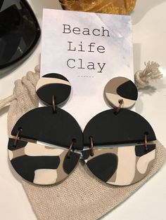 Stud dangle earrings Polymer clay funky hanging disc circle black ecru camo love fashionable Beach Life Clay statement design by Beachlifeclay on Etsy https://www.etsy.com/au/listing/528810461/stud-dangle-earrings-polymer-clay-funky