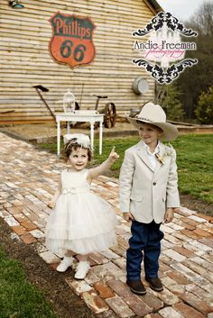 Ring bearer and flower girl.  Rustic Barn Wedding. Photography: www.TheAthensWeddingPhotographer.com  Planning, Floral, and Event Design: www.WildFlowerEventServices.com Venue: Antique Acres