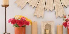 An East Indian sunburst mirror rests above the mantle in Leslie Burke's living room.   - Veranda.com