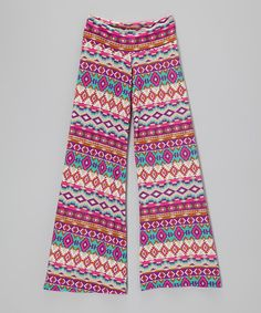 With a vibrant print and breezy, relaxed cut, these palazzo pants bring laid-back style to a glam gal's fashion palette. With a wide stretchy waistband and loose-fitting construction, their fabulous flair is comfy and cool.