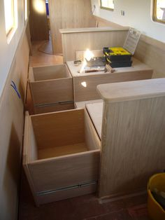 Canal Boat Pullman Dinette Therefore Richard designed and asked use to build slide out seats into the each of the dinette seats. Both slide out seats pictured here will have a reversible lid which will have upholstered foam attached on the underside.The lids will then be lifted off and turned over to form the two seats. We'll also be building a table extension that can also be used as a infill piece when the seats are out to form a large bed.