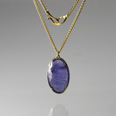"The simplicity of this Gabriella Kiss necklace has us swooning! The 18K yellow gold chain displays an oval faceted tanzanite that is perfectly held in an 18K yellow gold scalloped bezel. Fabulous layered and gorgeous all on its own, this piece is natural beauty at its best!<br><br>Pendant measures 1 1/8"" x 3/4"" on a 16"" chain"
