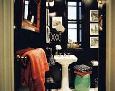 I love everything about this dramatic bathroom!